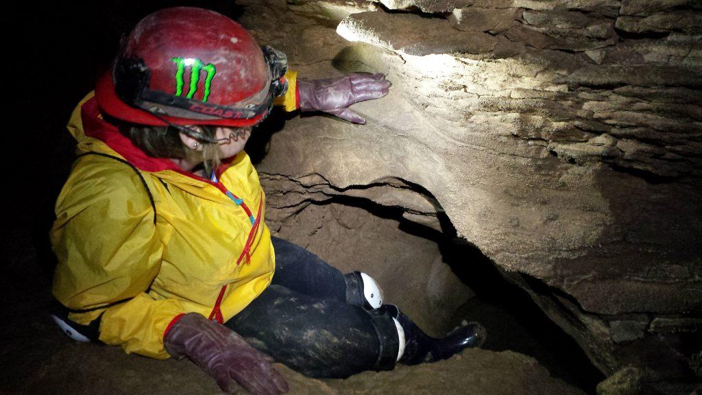 delania-soon-into-a-cranny-inside-wells-cave-river-passage-10-29-16